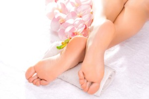 37399491 - foot massage in the spa salon with orchid
